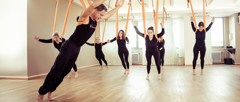 Aerial Yoga Pose Forward Lean in Class